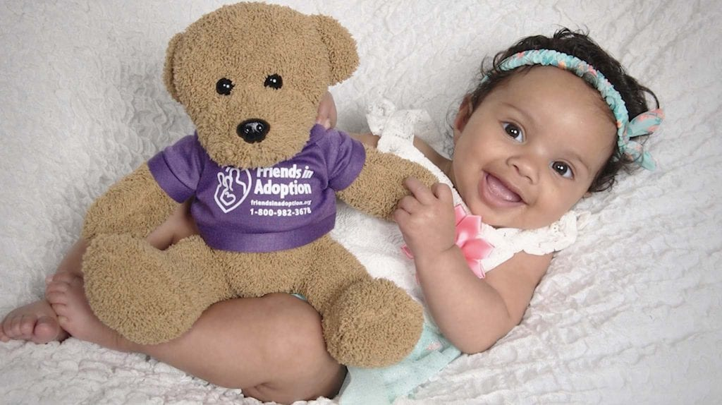 baby Harper with teddy bear wearing FIA shirt
